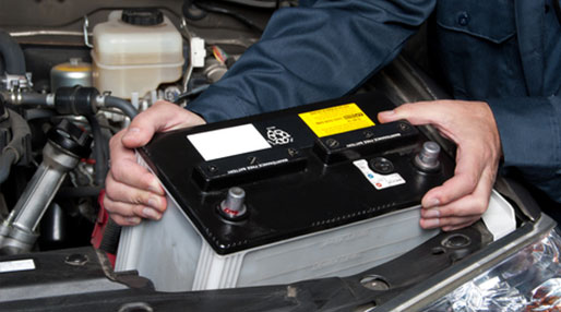 image of a car battery being removed