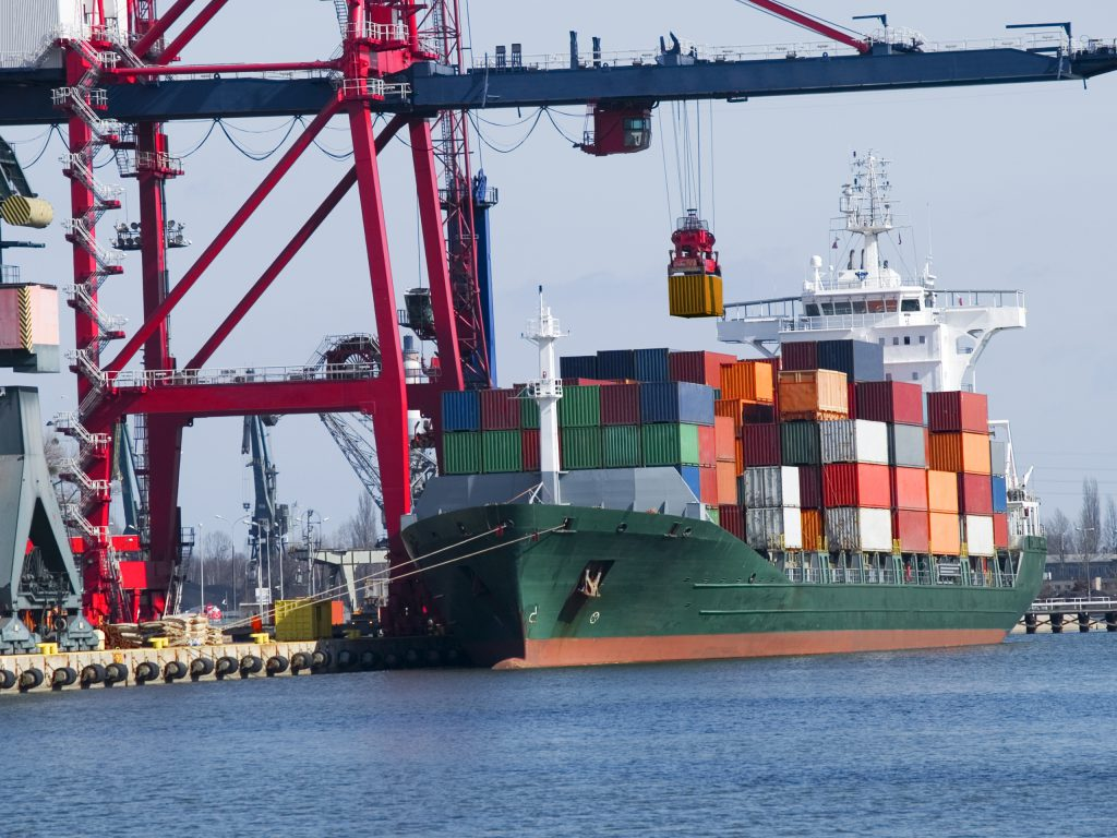 scrap metal and waste being brought in on Container Cargo Ship